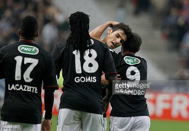 Alexandre Lacazette Bafetimbi Gomis Yoann Gourcuff and Lisandro Lopez of Lyon Olympique celebrate the goal of Lissandro Lopez during the French Cup...