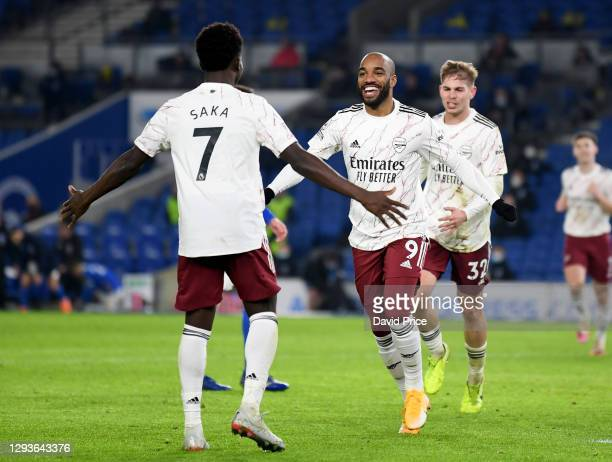 Alexandre Lacazette celebrate scoring a goal for Arsenal with Bukayo Saka during the Premier League match between Brighton & Hove Albion and Arsenal...