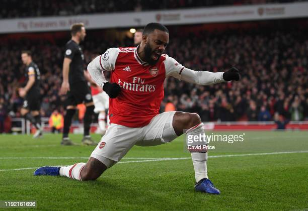 Alexandre Lacazette celebrates scoring a goal for Arsenal during the Premier League match between Arsenal FC and Brighton Hove Albion at Emirates...