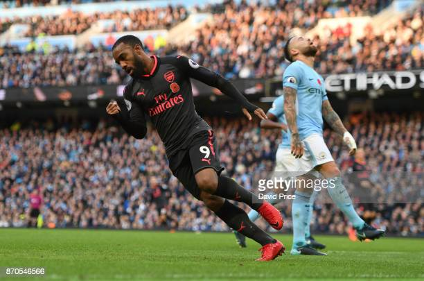 Alexandre Lacazette celebrates scoring a goal for Arsenal during the Premier League match between Manchester City and Arsenal at Etihad Stadium on...