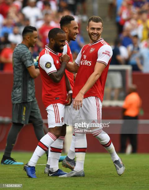 Alexandre Lacazette celebrates scoring Arsenal's 1st goal with Calum Chambers during the match against Real Madrid v Arsenal in the 2019...