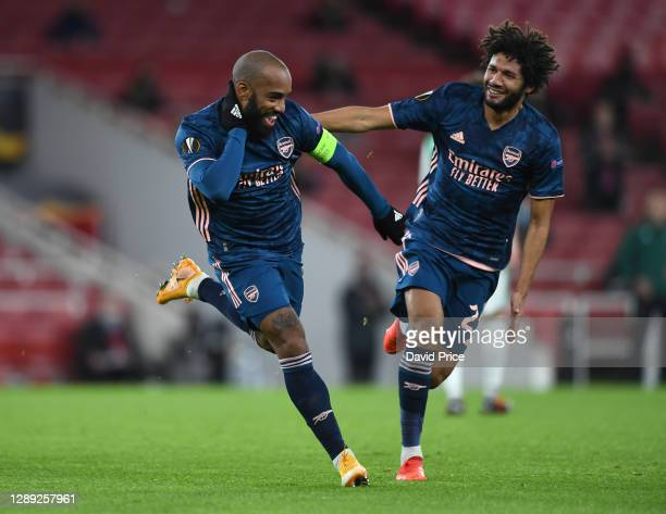 Alexandre Lacazette celebrates scoring Arsenal's 1st goal with Mohamed Elneny during the UEFA Europa League Group B stage match between Arsenal FC...