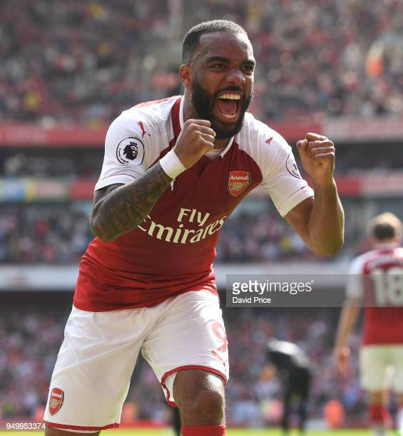 Alexandre Lacazette celebrates scoring Arsenal's 3rd goal during the Premier League match between Arsenal and West Ham United at Emirates Stadium on...