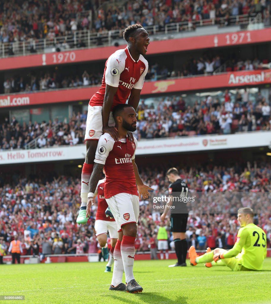 Alexandre Lacazette celebrates scoring Arsenal's 3rd goal with Danny Welbeck during the Premier League match between Arsenal and West Ham United at Emirates Stadium on April 22, 2018 in London, England.