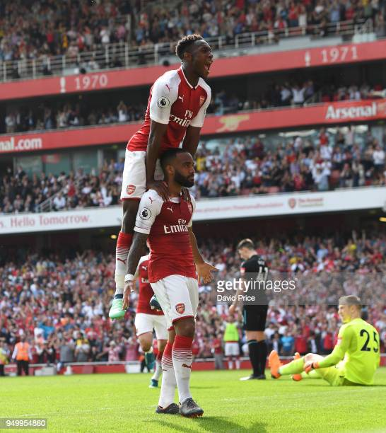 Alexandre Lacazette celebrates scoring Arsenal's 3rd goal with Danny Welbeck during the Premier League match between Arsenal and West Ham United at...