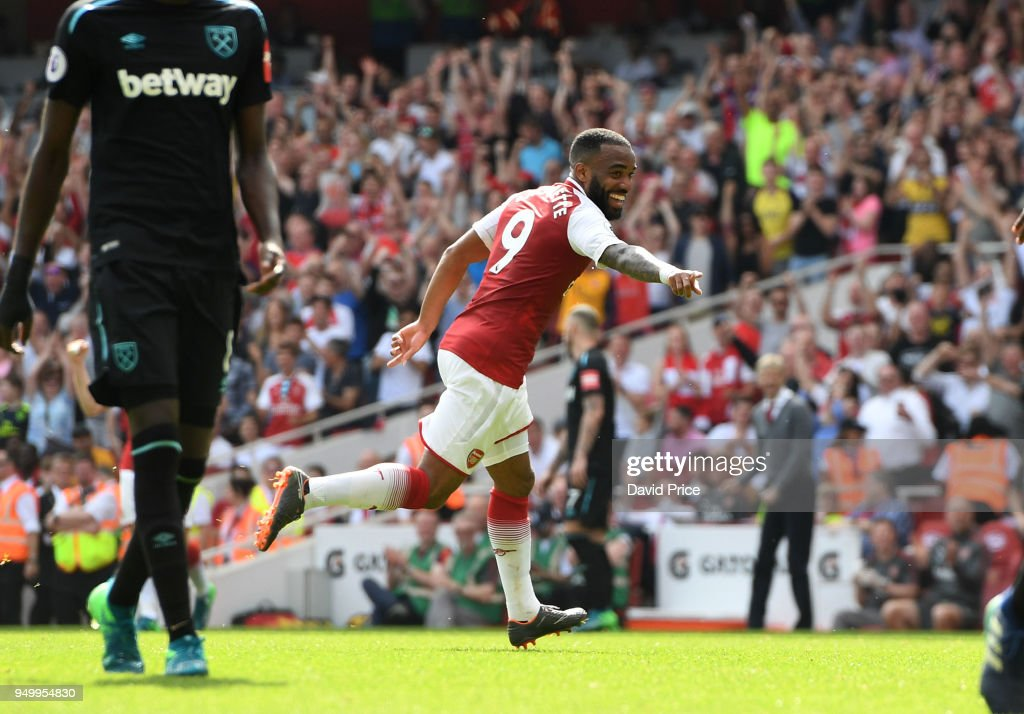 Alexandre Lacazette celebrates scoring Arsenal's 4th goal during the Premier League match between Arsenal and West Ham United at Emirates Stadium on April 22, 2018 in London, England.