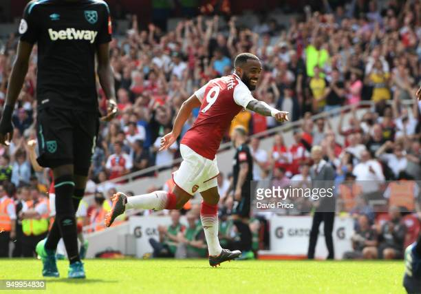 Alexandre Lacazette celebrates scoring Arsenal's 4th goal during the Premier League match between Arsenal and West Ham United at Emirates Stadium on...