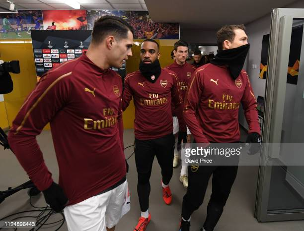 Alexandre Lacazette chats to Granit Xhaka of Arsenal before the UEFA Europa League Round of 32 First Leg match between BATE Borisov and Arsenal on...