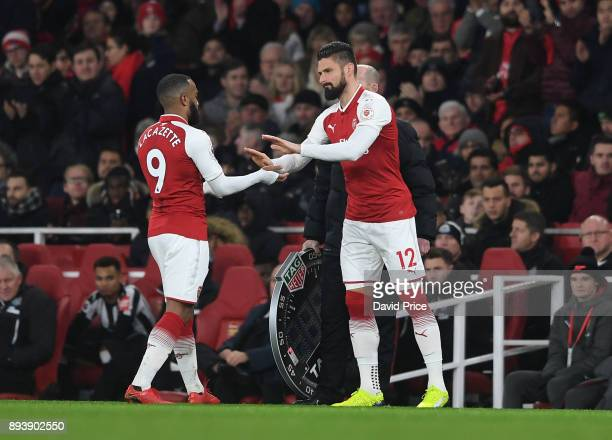 Alexandre Lacazette high fives Olivier Giroud of Arsenal as he comes off as a sub during the Premier League match between Arsenal and Newcastle...