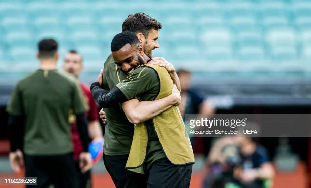 Alexandre Lacazette hugs Carl Jenkinson during Arsenal training session prior to the UEFA Europa League Final between Chelsea and Arsenal at Baku...