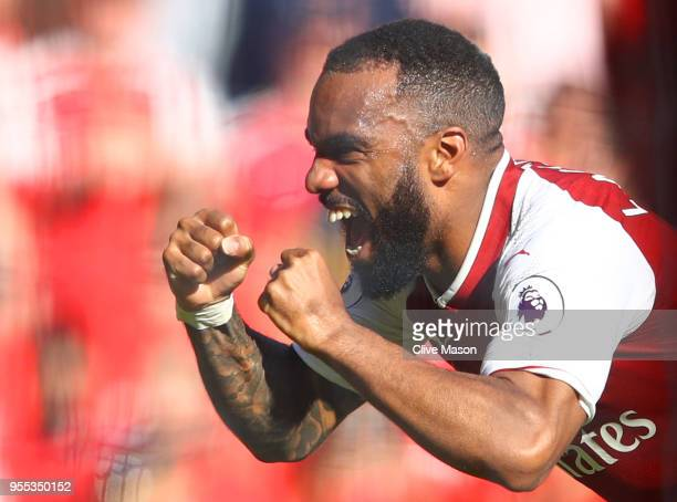 Alexandre Lacazette of Arscenal celebrates after scoring his sides second goal during the Premier League match between Arsenal and Burnley at...