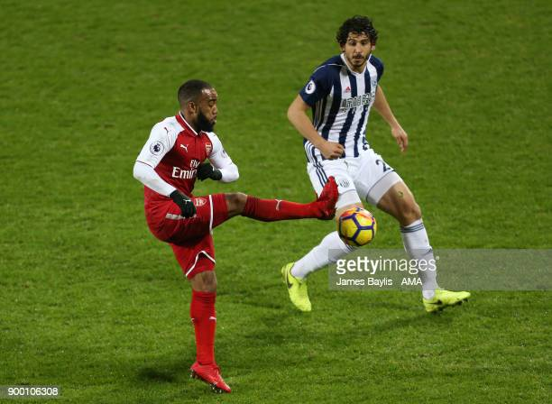 Alexandre Lacazette of Arsenal and Ahmed Hegazy of West Bromwich Albion during the Premier League match between West Bromwich Albion and Arsenal at...