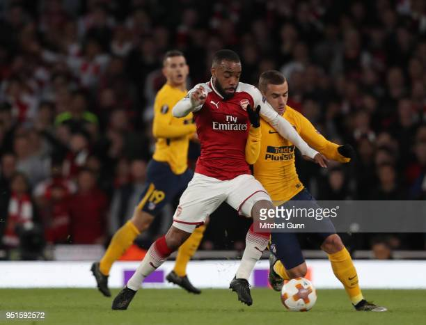 Alexandre Lacazette of Arsenal and Antoine Griezmann of Atletico Madrid compete for the ball during the Europa League semi final leg one match...