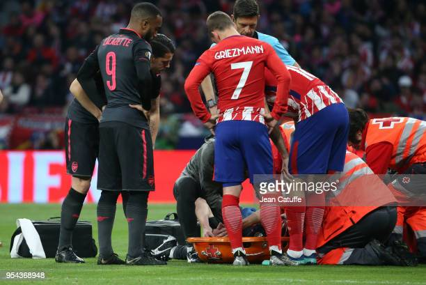 Alexandre Lacazette of Arsenal and Antoine Griezmann of Atletico Madrid worries for their teammate with the French team Laurent Koscielny of Arsenal...