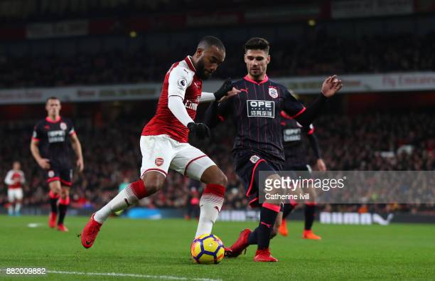 Alexandre Lacazette of Arsenal and Christopher Schindler of Huddersfield Town during the Premier League match between Arsenal and Huddersfield Town...
