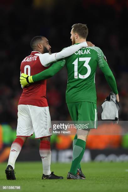 Alexandre Lacazette of Arsenal and Jan Oblak of AtlŽtico Madrid embrace at the end of the UEFA Europa League Semi Final leg one match between Arsenal...