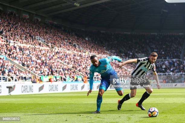 Alexandre Lacazette of Arsenal and Paul Dummett of Newcastle United during the Premier League match between Newcastle United and Arsenal at St James...