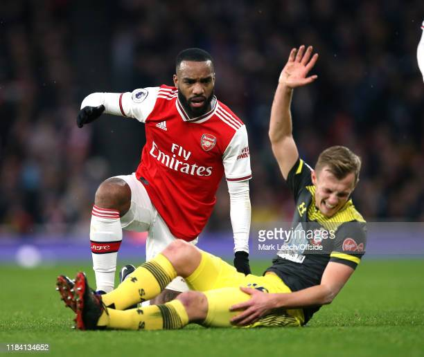 Alexandre Lacazette of Arsenal and the injured James WardProwse of Southampton during the Premier League match between Arsenal FC and Southampton FC...