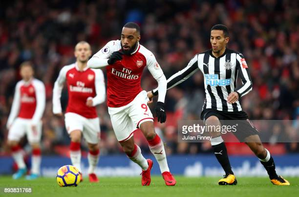 Alexandre Lacazette of Arsenal attempts to get away from Isaac Hayden of Newcastle United during the Premier League match between Arsenal and...