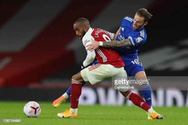 Alexandre Lacazette of Arsenal battles for possession with James Maddison of Leicester City during the Premier League match between Arsenal and...