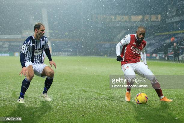 Alexandre Lacazette of Arsenal battles with Branislav Ivanovic of West Bromwich Albion during the Premier League match between West Bromwich Albion...