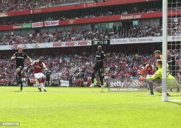 Alexandre Lacazette of Arsenal beats West Ham goalkeeper Joe Hart to score the fourth Arsenal goal during the Premier League match between Arsenal...