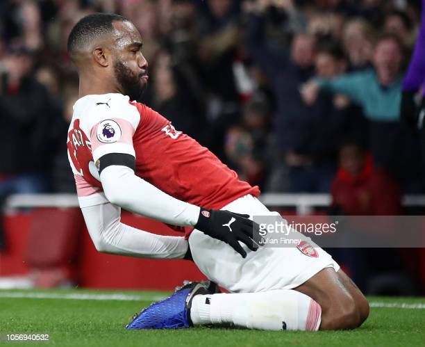 Alexandre Lacazette of Arsenal celebrates after he scores his sides first goal during the Premier League match between Arsenal FC and Liverpool FC at...