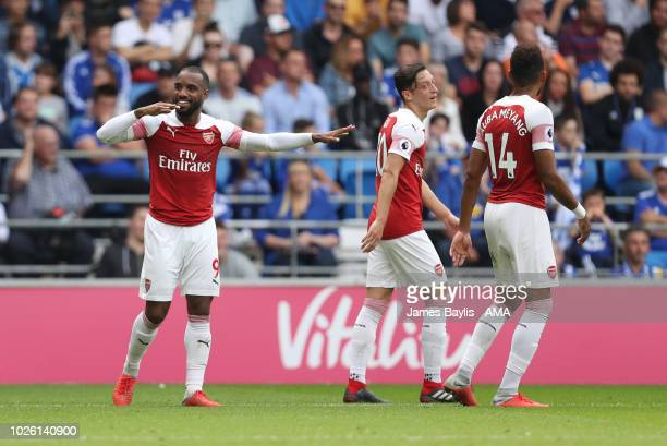 Alexandre Lacazette of Arsenal celebrates after scoring a goal to make it 23 during the Premier League match between Cardiff City and Arsenal FC at...