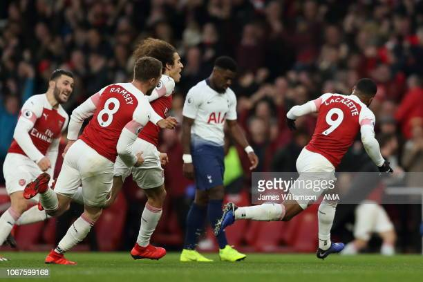 Alexandre Lacazette of Arsenal celebrates after scoring a goal to make it 32 during the Premier League match between Arsenal FC and Tottenham Hotspur...