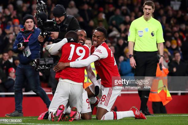 Alexandre Lacazette of Arsenal celebrates after scoring a goal to make it 40 with Nicolas Pepe and Joe Willock during the Premier League match...