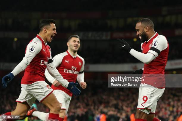 Alexandre Lacazette of Arsenal celebrates after scoring a goal to make it 10 during the Premier League match between Arsenal and Huddersfield Town at...