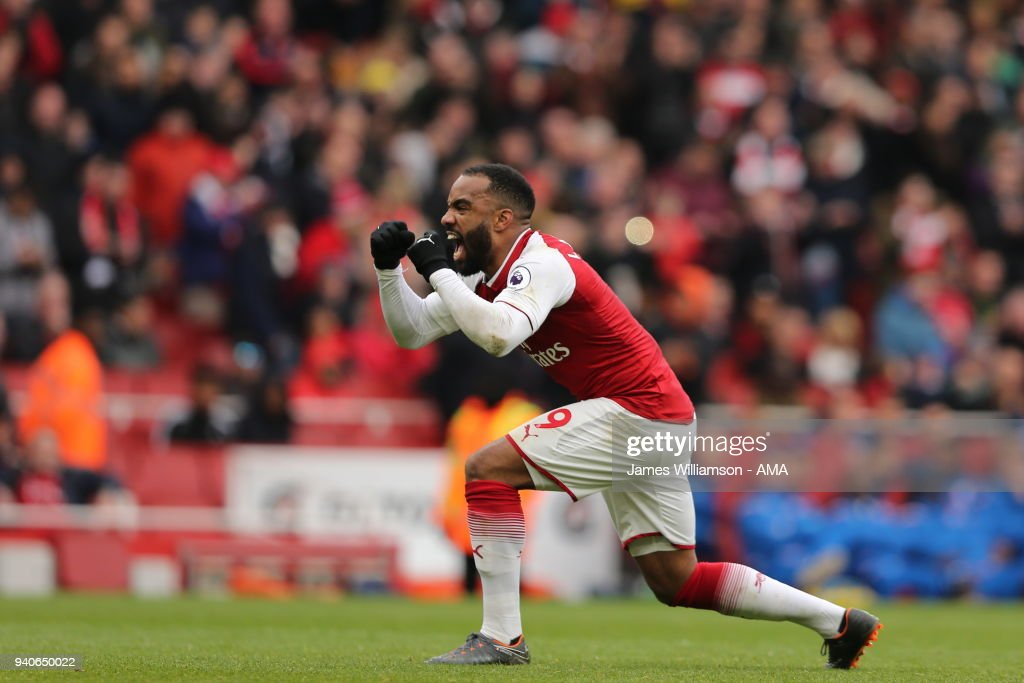 Alexandre Lacazette of Arsenal celebrates after scoring a goal to make it 3-0 during the Premier League match between Arsenal and Stoke City at Emirates Stadium on April 1, 2018 in London, England.