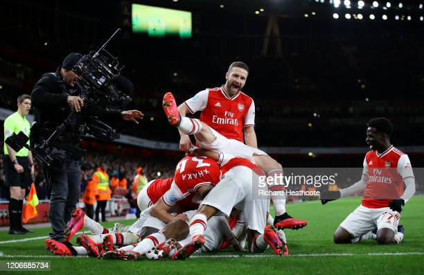 Alexandre Lacazette of Arsenal celebrates after scoring his sides fourth goal with Shkodran Mustafi and team mates during the Premier League match...