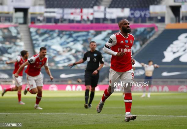 Alexandre Lacazette of Arsenal celebrates after scoring his sides first goal during the Premier League match between Tottenham Hotspur and Arsenal FC...