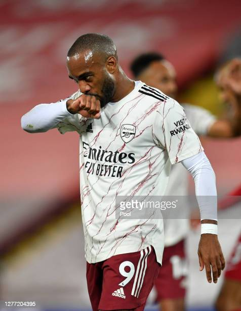 Alexandre Lacazette of Arsenal celebrates after scoring his sides first goal during the Premier League match between Liverpool and Arsenal at Anfield...