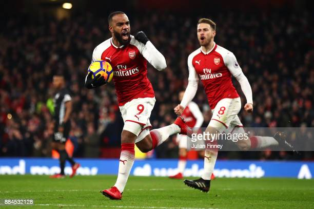Alexandre Lacazette of Arsenal celebrates after scoring his sides first goal during the Premier League match between Arsenal and Manchester United at...