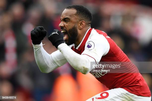 Alexandre Lacazette of Arsenal celebrates after scoring his sides third goal during the Premier League match between Arsenal and Stoke City at...