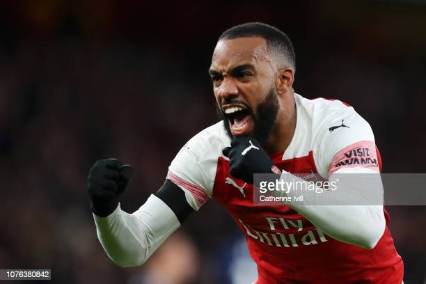 Alexandre Lacazette of Arsenal celebrates after scoring his team's second goal during the Premier League match between Arsenal FC and Fulham FC at...
