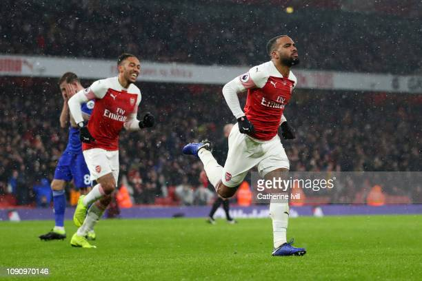 Alexandre Lacazette of Arsenal celebrates after scoring his team's second goal during the Premier League match between Arsenal and Cardiff City at...