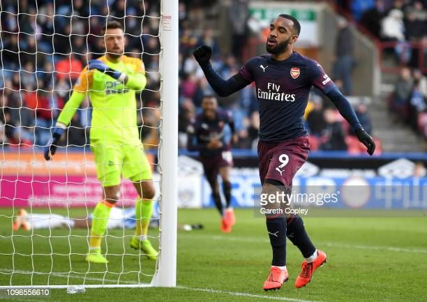 Alexandre Lacazette of Arsenal celebrates after scoring his team's second goal during the Premier League match between Huddersfield Town and Arsenal...