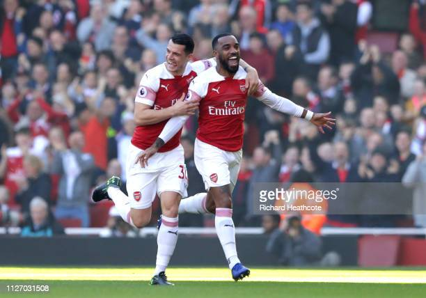 Alexandre Lacazette of Arsenal celebrates after scoring his team's first goal during the Premier League match between Arsenal FC and Southampton FC...
