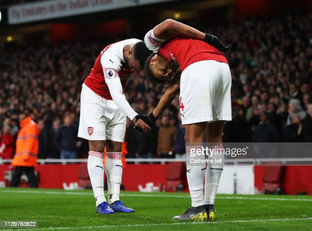 Alexandre Lacazette of Arsenal celebrates after scoring his team's second goal with PierreEmerick Aubameyang during the Premier League match between...
