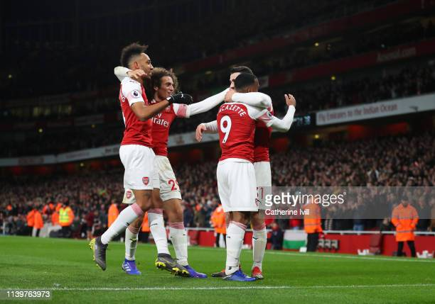 Alexandre Lacazette of Arsenal celebrates after scoring his team's second goal with team mates during the Premier League match between Arsenal FC and...