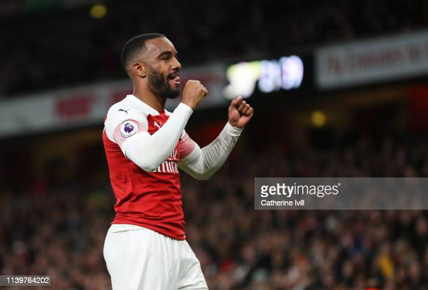 Alexandre Lacazette of Arsenal celebrates after scoring his team's second goal during the Premier League match between Arsenal FC and Newcastle...
