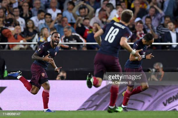 Alexandre Lacazette of Arsenal celebrates after scoring his team's second goal during the UEFA Europa League Semi Final Second Leg match between...