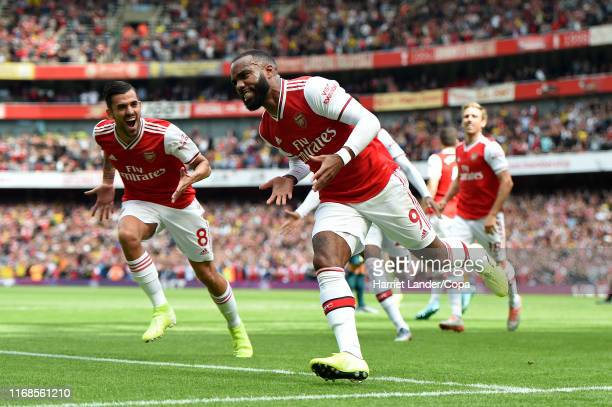 Alexandre Lacazette of Arsenal celebrates after scoring his team's first goal during the Premier League match between Arsenal FC and Burnley FC at...