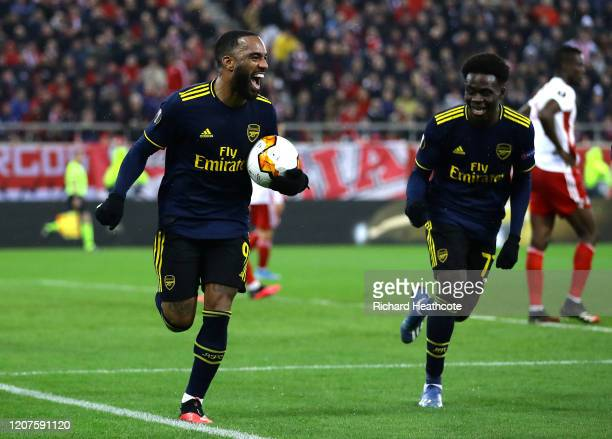 Alexandre Lacazette of Arsenal celebrates after scoring his teams first goal during the UEFA Europa League round of 32 first leg match between...