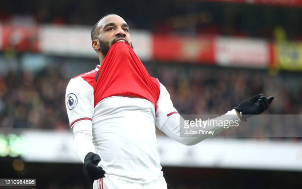 Alexandre Lacazette of Arsenal celebrates after scoring his team's first goal during the Premier League match between Arsenal FC and West Ham United...