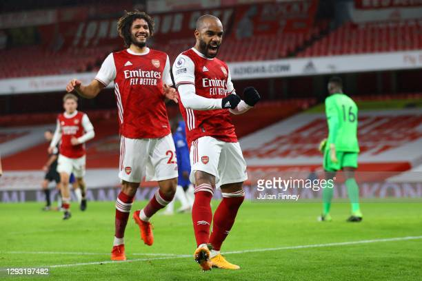 Alexandre Lacazette of Arsenal celebrates after scoring his team's first goal during the Premier League match between Arsenal and Chelsea at Emirates...
