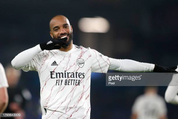 Alexandre Lacazette of Arsenal celebrates after scoring his team's first goal during the Premier League match between Brighton & Hove Albion and...